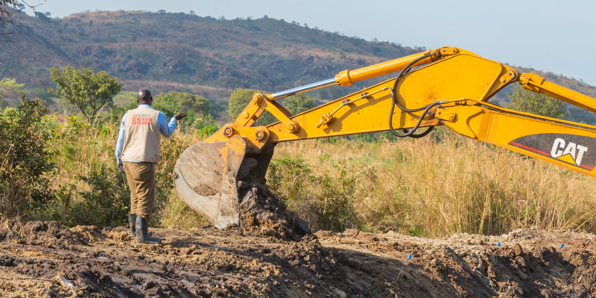 DRC Staff Supervises The Loader To Ensure The Dam Walls Are Well Constructed
